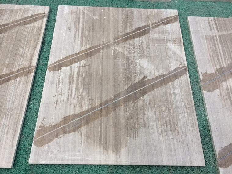 grey wooden marble with steel bar