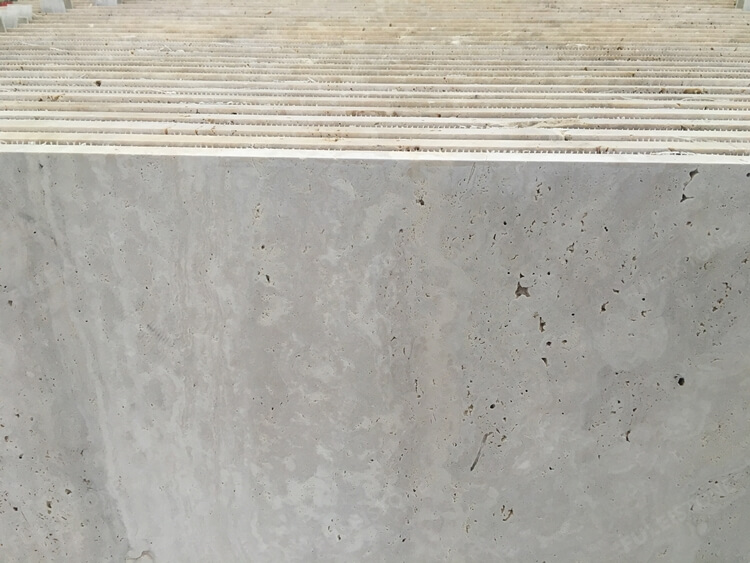 Cut to travertine tile
