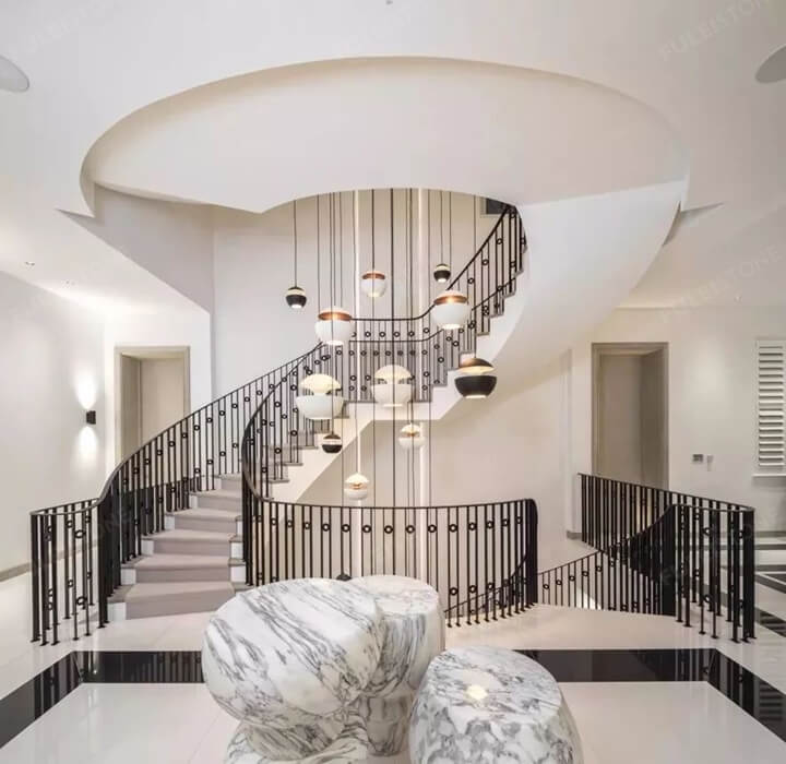 Staircases of metal and marble tile
