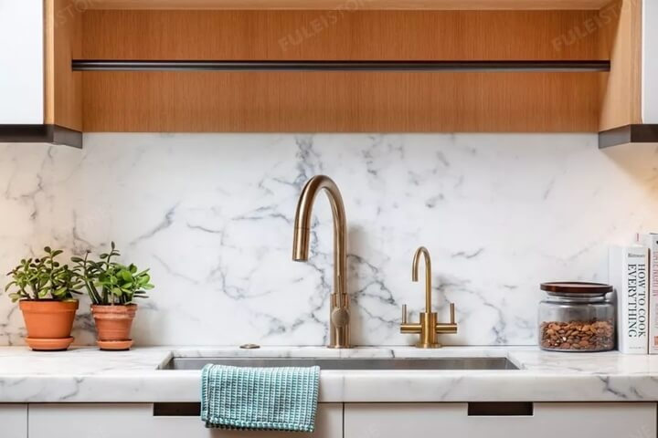 marble countertop with the metal faucet