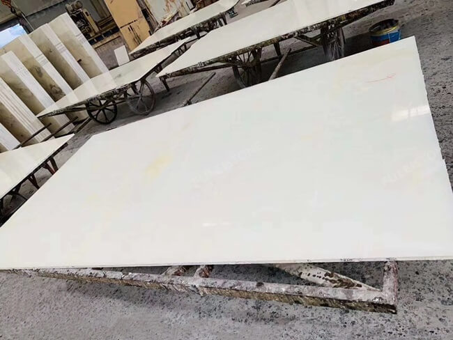 Snow white onyx slab filled with expoxy