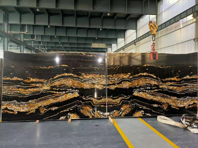 Black magma granite bookmatched with golden veins
