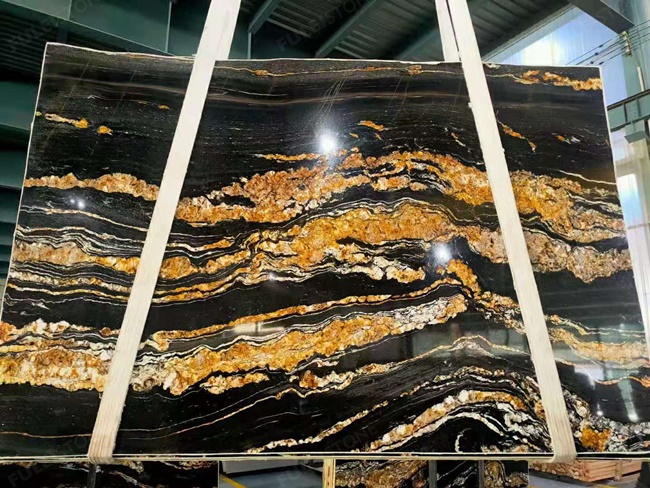 Black magma granite with clear golden veins