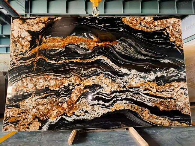 Black magma granite with full irregular veins