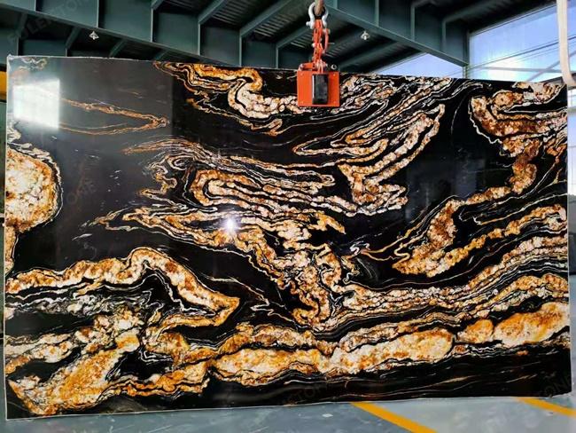 Black magma granite with golden dragon design