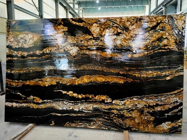 Black magma granite with straight golden veins