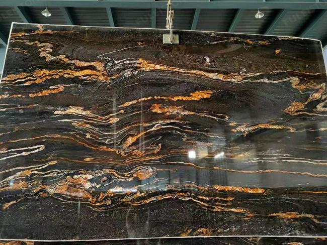 Black magma granite with thin golden veins