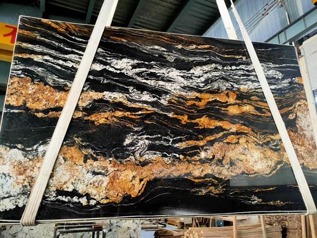 Black magma granite with white cloundy veins