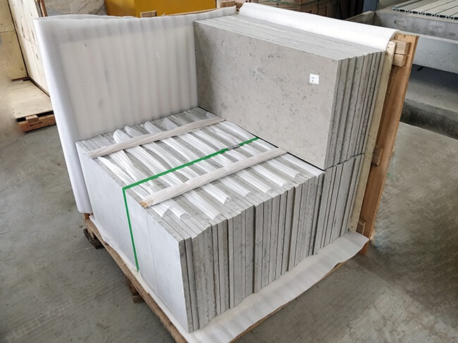 packing of honed jura grey limestone tiles