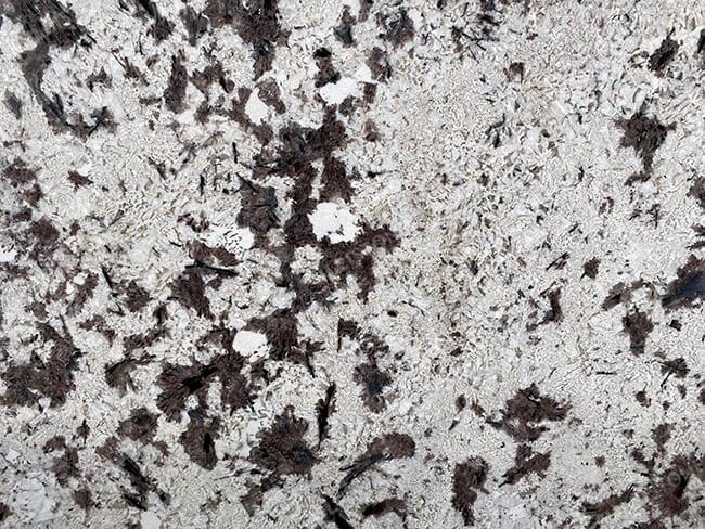 close up of polished everest white granite slabs (1)