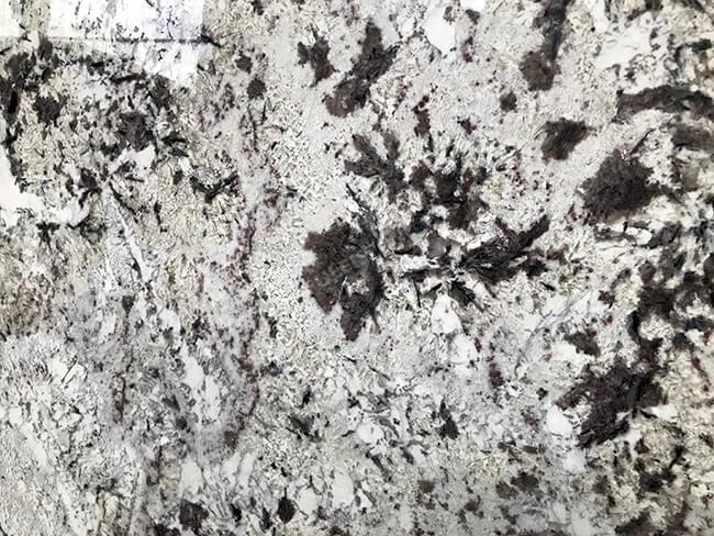 close up of polished everest white granite slabs (2)