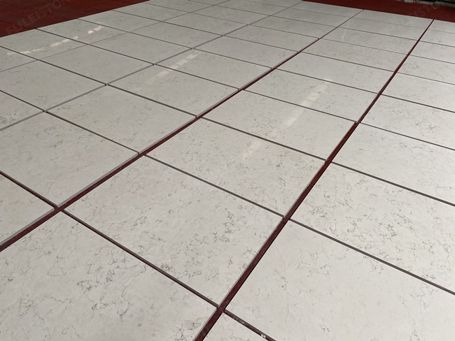 Dry-laying of Bianco Perlino Marble